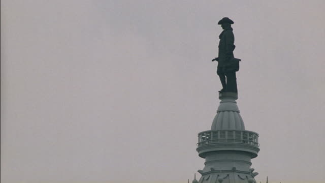 a statue of william penn stands on top of philadelphiaõs city hall. - william penn stock videos & royalty-free footage
