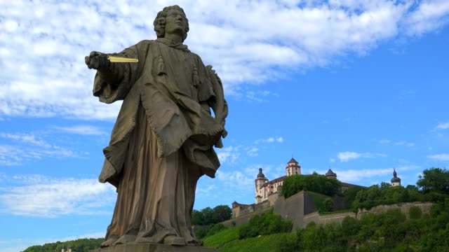 Statue on the Old Bridge across River Main with Marienberg Fortress, Wuerzburg, Lower Franconia, Bavaria, Germany