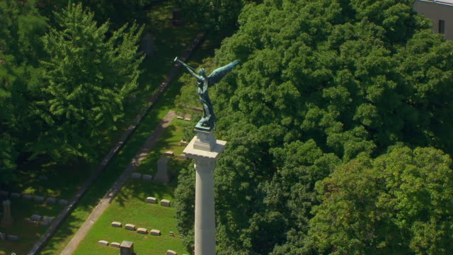 WS TU DS AERIAL POV Statue on top of Elijah P. Lovejoy Monument with cemetery in background / Alton, Illinois, United States