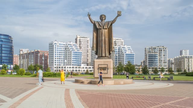 statue outside the national library of belarus, minsk, belarus - time lapse - belarus stock videos & royalty-free footage
