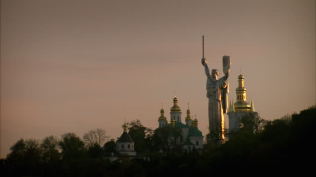 A statue overlooks Kiev Russia. Available in HD.