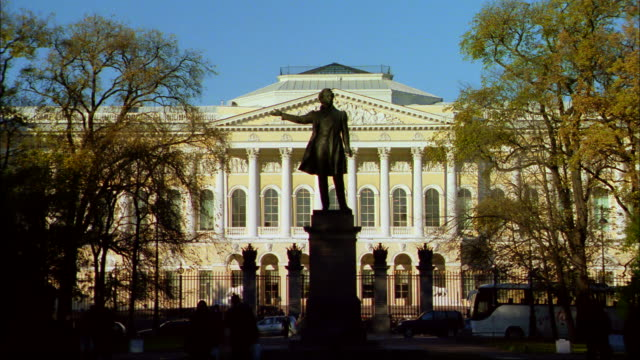 a statue stands on a pedestal in front of a portico. - st. petersburg russia stock videos & royalty-free footage