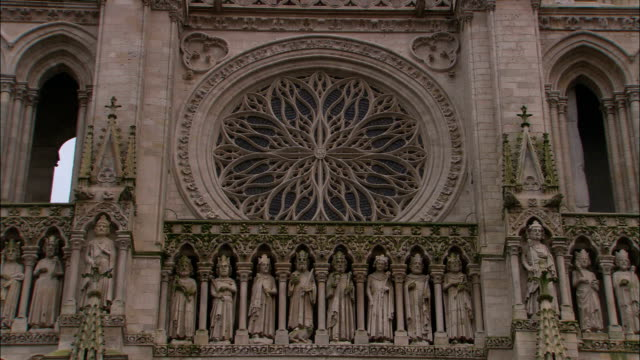 statues and a rose window decorate the exterior of the amiens cathedral. - rose window stock videos and b-roll footage