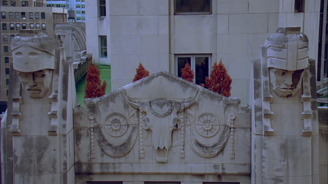ms statues and bas relief carving on city bank-farmers trust company building at 20 exchange place / manhattan, new york, new york, usa - relief carving stock videos & royalty-free footage