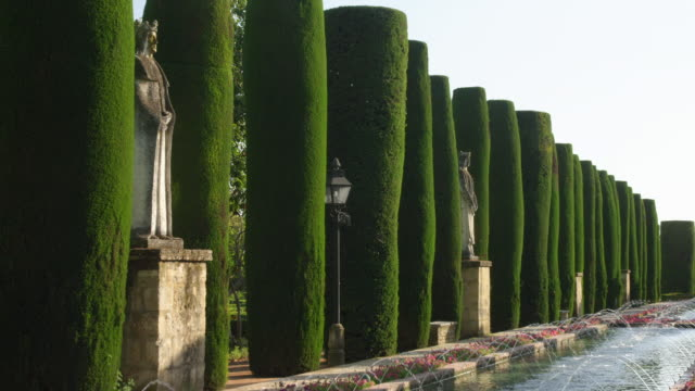 WS statues and cypress hedges in the gardens of the Alcazar Palace