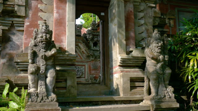 ms statues at entrance of temple, ubud, bali, indonesia - ubud stock videos & royalty-free footage