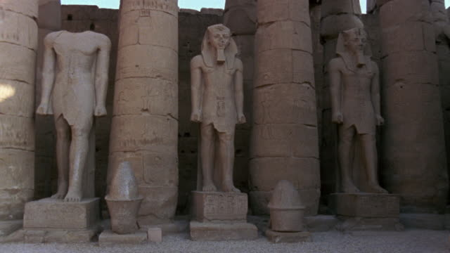 ws statues at luxor temple/ luxor, egypt - three objects stock videos & royalty-free footage