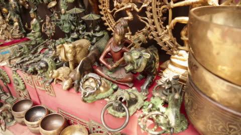 statues at market stall, rishikesh, uttarakhand, india - female likeness stock videos & royalty-free footage