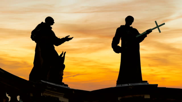 statues at sunset, time lapse - minister clergy stock videos and b-roll footage