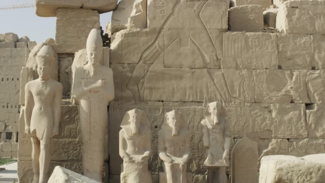 statues at the temple of karnak, near luxor, egypt. - temples of karnak stock videos and b-roll footage
