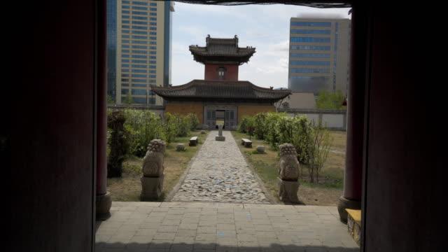 statues by footpath leading traditional building at choijin lama temple - ulaanbaatar, mongolia - ulan bator stock videos & royalty-free footage