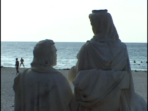 cu, statues facing varadero beach, rear view, havana, cuba - varadero beach stock videos and b-roll footage