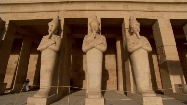 Statues of Hatshepsut decorate her temple at Deir el-Bahri. Available in HD.