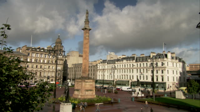 Statues of Thomas Graham and Walter Scott in George Square, Glasgow, Scotland. Available in HD.