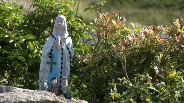 statues of womanly saint and three children - nun stock videos & royalty-free footage