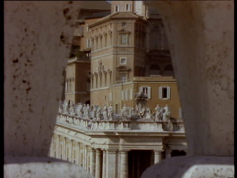Statues on top of colonnade in Vatican city shot through gap in columns on opposite side Vatican City