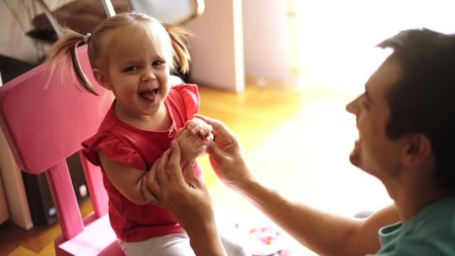 stay at home father and his daughter - genderblend stock videos & royalty-free footage