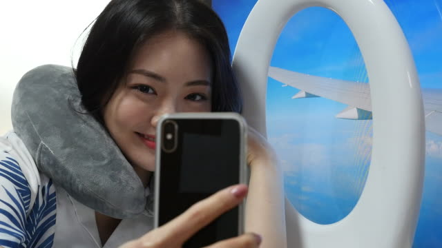 stay at home - young woman taking selfies in front of the digital screen like traveling abroad - stationary process plate stock videos & royalty-free footage