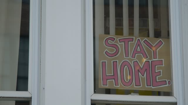 "stay home"" sign sits in a window of a baltimore rowhome on december 4, 2020 in baltimore, maryland. maryland hit broke a previous record friday,... - epidemic stock videos & royalty-free footage"