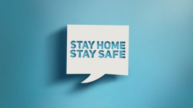 stay home stay safe warning text in square speech bubble on blue background in 4k resolution - prevenzione delle malattie video stock e b–roll