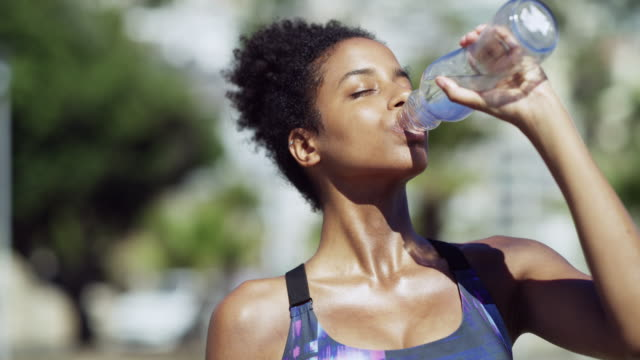 stay hydrated to maximise on your workout - drinking stock videos & royalty-free footage
