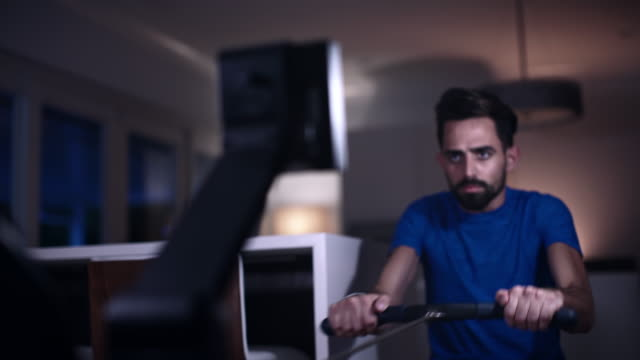 stay in form while staying home - rowing machine stock videos & royalty-free footage