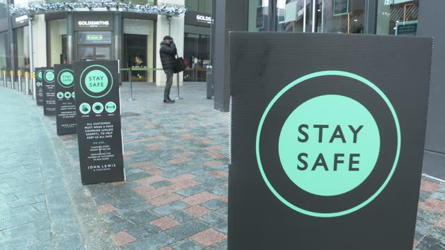 stay safe and health warning signs on chelmsford high street on december 31, 2020 in chelmsford, england. - illness prevention stock videos & royalty-free footage