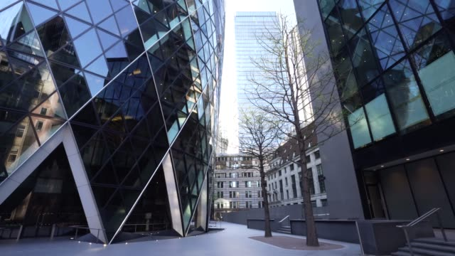 steadicam a normally busy walking area is empty during rush hour outside of 30 st mary axe building during the global outbreak of coronavirus covid19... - time stock videos & royalty-free footage