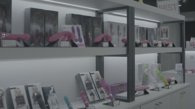 steadicam across toys in seoul sex shop, slow motion - sex toy stock videos and b-roll footage