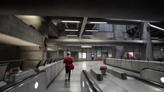 steadicam an almost empty transport for london westminster underground station during rush hour due to the global outbreak of coronavirus covid19... - time stock videos & royalty-free footage