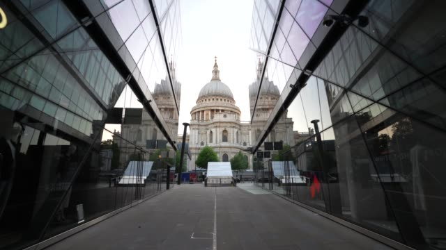 steadicam closed off and empty shopping stores in one new change next to st paul's cathedral during the global outbreak of coronavirus covid19... - cathedral stock videos & royalty-free footage