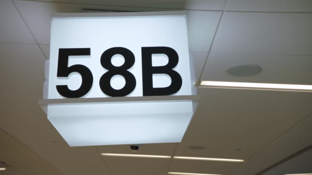 cu steadicam gate sign 58b at sfo - hanging sign stock videos and b-roll footage