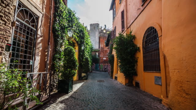 steadicam: idyllic narrow street in rome, trastevere - rome italy stock videos & royalty-free footage