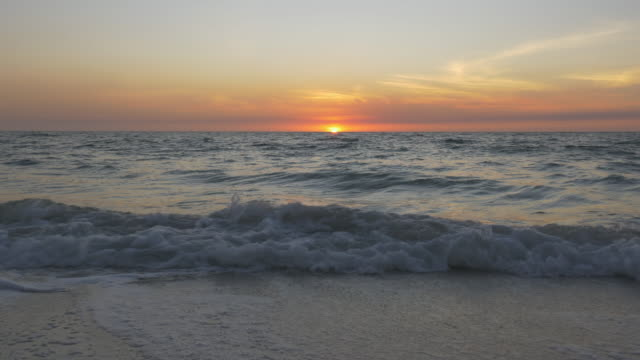 steadicam low angle shot of ocean sunset - naples florida stock videos & royalty-free footage
