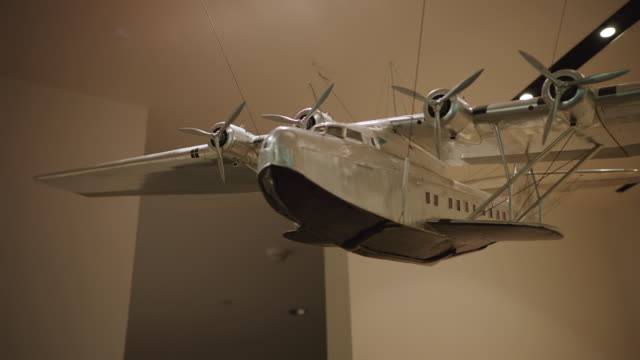 ms steadicam of china clipper model plane in sfo museum - museum stock videos & royalty-free footage
