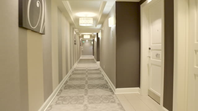 steadicam shot of a hotel interior - corridor stock videos & royalty-free footage