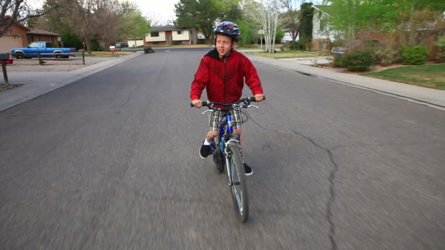 hd steadicam:boy riding bike - sports helmet stock videos & royalty-free footage