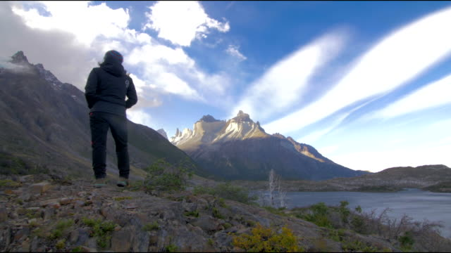 steady cam shot of a woman looking at the landscape - patagonia chile stock videos and b-roll footage