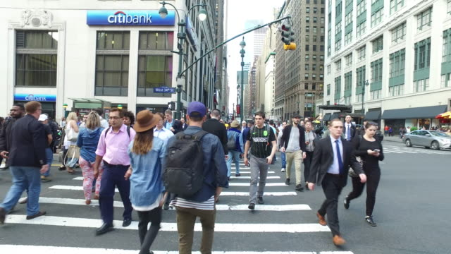 Steady Cam Shot of Crowds of People Walking and Crossing in New York Manhattan During Rush Hour