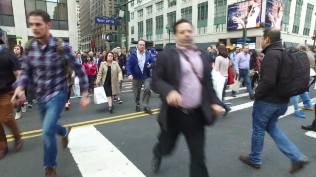 steady cam shot of crowds of people walking and crossing in new york manhattan during rush hour - crosswalk sign stock videos & royalty-free footage
