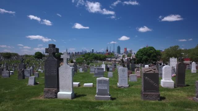 Steady cam shot of New York City Calvary Cemetery and Manhattan Buildings