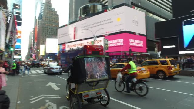 Steady Cam Shot of People Walking and Traffic in Manhattan Times Square
