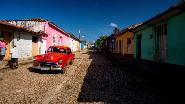 steady cam shot of trinidad cuba with vintage car - cuba stock videos & royalty-free footage
