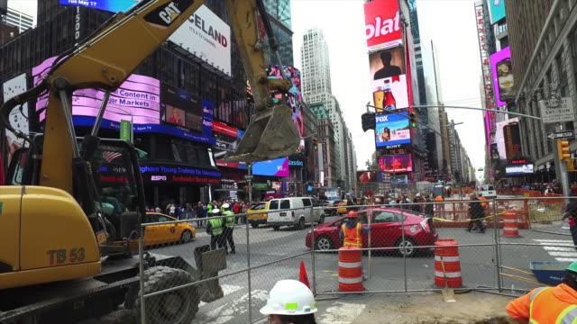 Steady Cam shot of truck and worker working at construction site in New York Times Square
