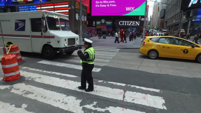 Steady Cam shot of workers and NYPD in New York Times Square