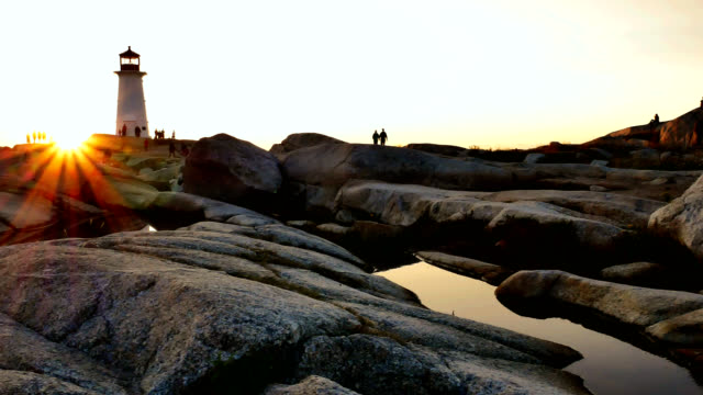 steady cam sunset at peggy's cove - nova scotia stock videos and b-roll footage