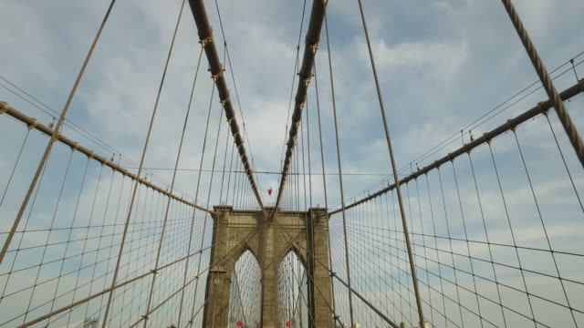 Steady cam walking shgot of tourists on top of the Brooklyn bridge
