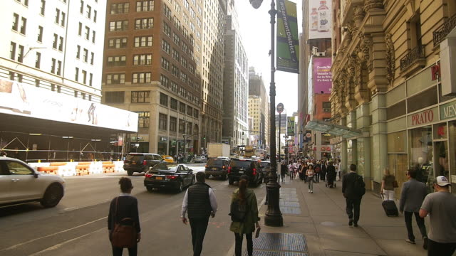 steady cam walking shot of people striding in new york manhattan - striding stock videos & royalty-free footage