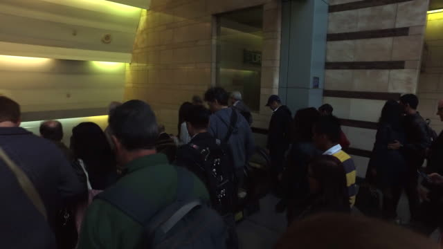 steady cam walking shot of people walking down to penn station in new york city - new york city penn station stock videos & royalty-free footage