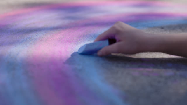 cu steady hand sketches colorful rainbow on the sidewalk - child stock videos & royalty-free footage